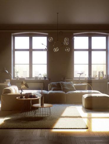 Wohnzimmer mit warmem Sonnenlicht das durch die Fenster fällt